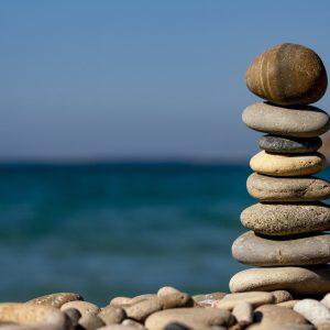 pebbles balancing on beach